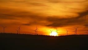 Electric wind turbines farm silhouettes on sunrise. stock video footage