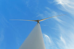Electric windmill on a sky background. Progressive windmill technologies. Renewable energy sources concept. Copy space. A view from the bottom of a modern Royalty Free Stock Images