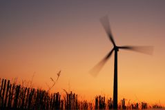 Electric windmill at sunset Royalty Free Stock Image