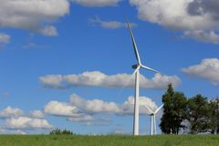 Electric Windmills with blue sky and white clouds royalty free stock photography