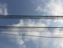 Electric Wire. Blue Sky Background in a sunny day Royalty Free Stock Photography