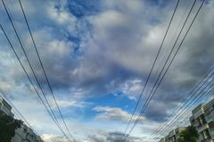 Electric wire on blue sky cloud Stock Photos