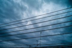 Electric wire and cloud Stock Photo