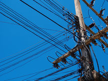 Electric wire / a confusion Electric wire. In blue sky Royalty Free Stock Photography