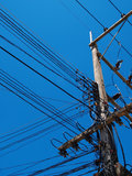Electric wire / a confusion Electric wire. In blue sky stock image