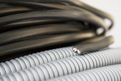 Electric wire and corrugation Royalty Free Stock Image