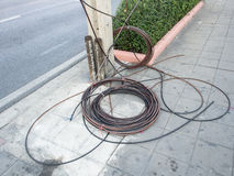 Electric wire pile aside electricity post waiting for set up Royalty Free Stock Photos