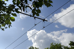 Electric wire of trolley bus. Blue sky with clouds royalty free stock photos