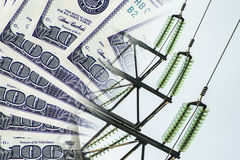 Electric and wires on a background of money . The concept of raising electricity tariffs Stock Image