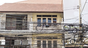 Electric wires in city in Thailand Stock Photos