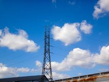 Telephone wires against a bright blue sky Royalty Free Stock Photos