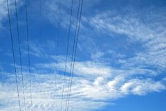 Electric wires in the sky. Close view Royalty Free Stock Photo