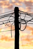 Electric wires at sunset as an background Stock Photography