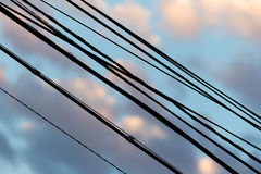 Electric wires at sunset as an background Royalty Free Stock Photography