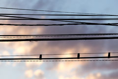 Electric wires at sunset as an background. Electric wires at sunset as an abstract background Stock Photos