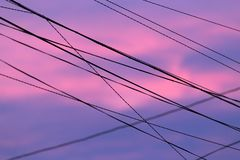 Electric wires at sunset. Photo of an abstract texture Stock Images