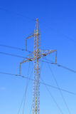 Electric wires and tall sturdy. High-voltage line against the blue sky Royalty Free Stock Images