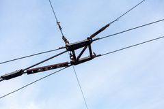 Electric wires for trolleybus. Element of electric transport. Parallel trolley and tension wire for a trolleybus against a cloudy sky royalty free stock photos