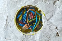 Electric wires in the wall Stock Photo