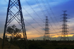 Electrical. Transmission tower with sunset background Stock Images
