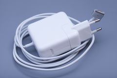 Electrical adapter to USB port on a gray Royalty Free Stock Images