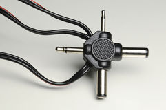 Electrical adaptor with jack plugs Royalty Free Stock Photo