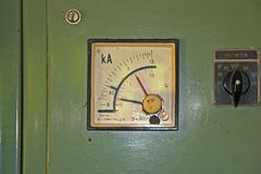 Electrical Amp meter. Electrical Meter showing current in Kilo Amps on old-fashioned switchboard stock photo
