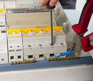 Electrical appliance repairs. electrician fixing Stock Photos