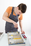 Electrical appliance repairs. electrician fixing Stock Image