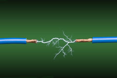 Electrical arc. An electrical arc crossing two blue, copper wires on a green and black gradient background Stock Photos