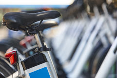 Electrical bikes on a parking. Charging batteries. Renewable ene royalty free stock photography
