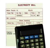 Electricity bill, calculator isolated. Electricity bill and calculator is isolated on white . Concept stock photos