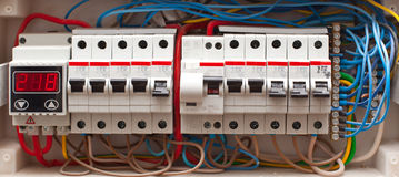 Electrical board. Automatic electrical fuse boxes and power lines located inside of an industrial switch control panel board electrical board Royalty Free Stock Photo