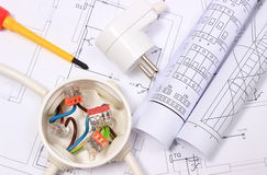 Electrical box, electric plug and diagrams on construction drawing Stock Images