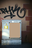 Electrical box in front of striking wall Stock Photos