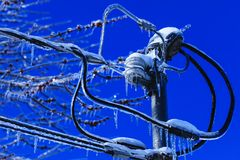 Electrical box installation with crystal icicles hanging from the wires. Weather winter disaster in North America. Ice catastrophe. In the cold Canadian spring stock photos