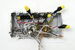 Electrical Box with Wires Hanging Out. Quad-sized electric box during wiring showing the tangle of wires inside.  Image in horizontal format Stock Images