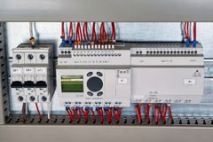 In the electrical Cabinet circuit breaker, control relay, expansion unit. royalty free stock image