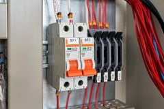 In the electrical Cabinet circuit breakers and fuse holders. royalty free stock photos