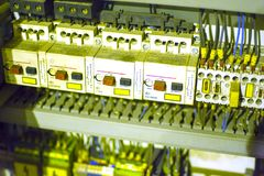 Electrical cabinet. Components of the CNC machine body. Relay and wiring lathe. soft focus stock photos