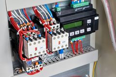 In the electrical Cabinet contactors and control relay. royalty free stock image
