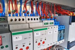 In the electrical Cabinet of the device with adjustment, relay and controller. Wires or cables are connected to the equipment according to the project or royalty free stock image