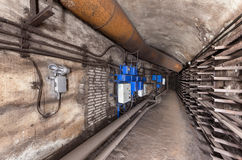 Electrical cabinets and other equipment in underground communication tunnel.  stock images