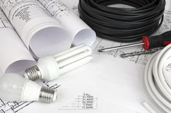 Electrical cable and bulbs on the drawings Royalty Free Stock Images