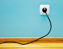 Electrical cable into the socket. Royalty Free Stock Photo