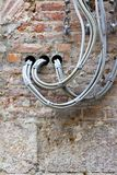 Electrical cables fixed on the wall Royalty Free Stock Photo