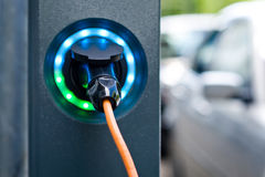 Electric car charging, battery charger socket Royalty Free Stock Images