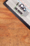Electrical circuit on breadboard on dirty wood Royalty Free Stock Images