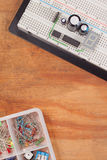 Electrical circuit on breadboard on dirty wood Stock Photo