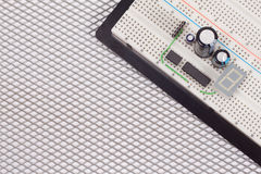 Electrical circuit on breadboard on isolated steel Royalty Free Stock Photo